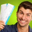Stock Photo: A Young Man Holding Tickets