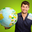 A Young Man Holding Tickets And Globe — Stock Photo #12665353