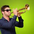 A Young Man Blowing A Trumpet — Stock Photo