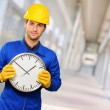 Engineer Holding Wall Clock — Stock Photo