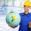 Engineer Holding Globe And Brick — Stock Photo