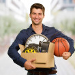 Man Holding Box And Basketball — Stock Photo