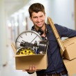 Man Holding Box And Picture Frame — Stock Photo #12665687