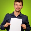 Young Man Holding Blank Paper — Stock Photo #12666581