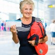 Woman Holding Boarding Pass And Luggage — Stock Photo