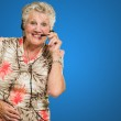 Senior Woman With Telephone Headset — Stock Photo #12666885