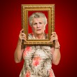 Unhappy Senior Woman Holding Picture Frame — Stock Photo #12666891