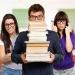 Student Carrying Stack Of Books - Stock Photo