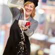 Portrait of a woman pouring milk — Stock Photo