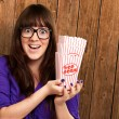 Casual Woman Holding Popcorn Container - Stock Photo