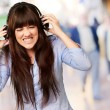 Stock Photo: Irritate Girl listening Music