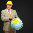 Male Architect Pointing At World Globe — Stock Photo #12667722