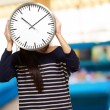 Young Girl Showing Clock And Hiding Her Face — Stock Photo