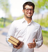 Portrait Of A Student Holding Book — Stock Photo