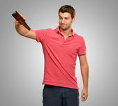 Portrait Of Young Man Holding Empty Bottle — Stock Photo