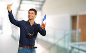 Man holding flag and miniature of airplane — Stock Photo