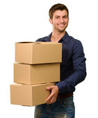 A Young Man Holding A Stack Of Cardboard Boxes — Stock Photo
