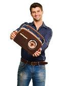 молодой человек, держащий ретро радио — Стоковое фото