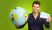 A Young Man Holding Tickets And Globe — Stock Photo