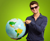 A Young Man Pointing On A Globe — Stock Photo