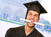 Man With Graduation Certificate In Mouth — Stock Photo