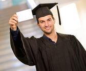 Cartellone di laurea uomo azienda — Foto Stock