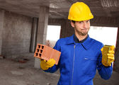 Engineer Holding Brick And Gold Bar — Stock Photo