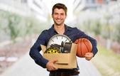 Man Holding Box And Basketball — Stock Photo