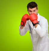 Doctor Wearing Boxing Gloves — Stock Photo