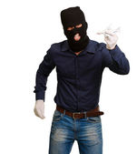 Man wearing robber mask and holding airplane miniature — Stock Photo
