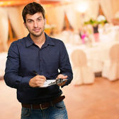 Young Man Holding Clipboard — Stock Photo