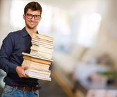 Young Man Holding Books — Stock Photo