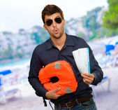 Man Standing With Boarding Passes And Bag — Stock Photo