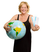 Woman Standing With World Globe And Boarding Passes — Stock Photo