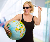 Woman Holding A Miniature Airplane And Globe — Stock Photo