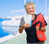 Woman Standing With Tickets And Bag — Stock Photo