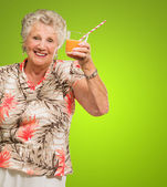 Senior Woman Holding Orange Juice Glass — Stock Photo