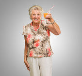 Senior Woman Holding Orange Juice Glass — Stock Photo