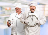 Portrait Of Angry Chef Holding Clock — Stockfoto