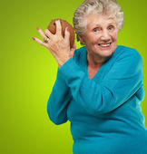 Senior happy woman holding coconut — Stock Photo