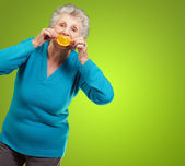 Mature Woman With A Slice Of Fruit — Stock Photo
