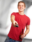 Portrait of a young man with remote control — Stock Photo
