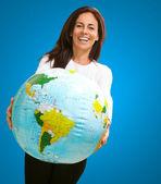 Women holding a globe — Stock Photo