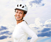 Woman wearing helmet with hand on hip — Stock Photo