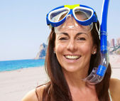 Portrait of a happy middle aged woman wearing snorkel and goggle — Stock Photo