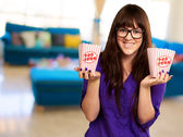 Casual Woman Holding Popcorn Container — Stock Photo