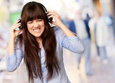 Irritate Girl listening Music — Stock Photo