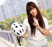 Portrait Of A Young Female Holding A Helmet — Stockfoto