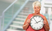 Senior Woman Holding A Clock — Stock Photo