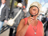 Senior Woman Looking Through A Magnifying Glass — Stok fotoğraf